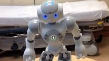 """Also known as """"Soother-Bot,"""" MEDi lights up, moves and talks to children so that they're not focusing on what nurses are doing in the room. (YouTube)"""