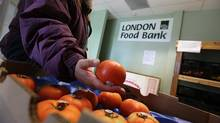 A number of people using the London Food Bank in London on Sept. 24, 2012. An annual count by Food Banks Canada shows 833,098 people turned to a food bank in March of 2013, near record levels and 23 per cent higher than before the recession. (DEBORAH BAIC/THE GLOBE AND MAIL)