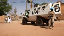 """An armoured personnel carrier of The United Nations Multidimensional Integrated Stabilization Mission in Mali (MINUSMA) is parked in Timbuktu on September 19, 2016. The doors of a revered 15th-century mosque hacked apart by jihadists in Mali's ancient city of Timbuktu four years ago were unveiled on September 19, 2016 restored to their former glory. The """"secret door"""" of the Sidi Yahia mosque in the fabled caravan city fell victim to a spree of destruction in 2012 by Al-Qaeda-linked Ansar Dine, one of several radical Islamist groups which seized key northern cities that year. / AFP / SEBASTIEN RIEUSSEC (Photo credit should read SEBASTIEN RIEUSSEC/AFP/Getty Images) (SEBASTIEN RIEUSSEC/AFP/Getty Images)"""