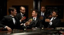 Men in dinner jackets drinking cocktails in bar (Chris Clinton/Getty Images)