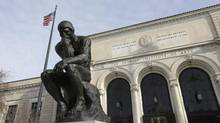 In a photo from Tuesday, Dec. 10, 2013 at the Detroit Institute of Arts in Detroit, The Thinker, a sculpture by Auguste Rodin is seen outside the art museum. (AP Photo/Carlos Osorio) (Carlos Osorio/AP)