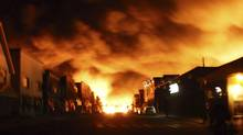 Fire from a train explosion is seen in Lac-Mégantic, July 6, 2013. (REUTERS)
