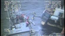 U.S. Coast Guard search-and-rescue crews rescue nine crew members from the Canadian Tall Ship Liana's Ransom on March 30, 2015. (U.S. COAST GUARD/THE CANADIAN PRESS)