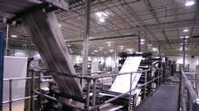 A file photo of printing presses and rolls of paper at a Transcontinental plant. (Tibor Kolley/The Globe and Mail)