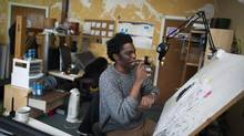 Johnnie Christmas, who is drawing and inking a Margaret Atwood written comic book series called Angel Catbird, works at his studio in Vancouver, British Columbia, Thursday, January 21, 2016. (Rafal Gerszak For The Globe and Mail)