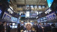 Trader Peter Tuchman works on the floor of the New York Stock Exchange in New York, April 14, 2014. (CARLO ALLEGRI/REUTERS)