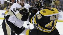 Pittsburgh Penguins defenseman Brooks Orpik (44) checks Boston Bruins center David Krejci (46) during the second period in Game 3 of the Eastern Conference finals in the NHL hockey Stanley Cup playoffs, in Boston on Wednesday, June 5, 2013. (Elise Amendola/AP)