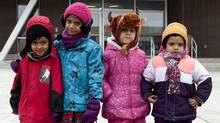 Zain Siddiqui, 4, Neha Charles, 5, Aizah Kamran, 5, and Manha Idrees, 4, are pupils at Fraser Mustard Learning Academy in Toronto. (DEBORAH BAIC/THE GLOBE AND MAIL)