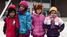 Zain Siddiqui, 4, Neha Charles, 5, Aizah Kamran, 5, and Manha Idrees, 4, are pupils at Fraser Mustard Learning Academy in Toronto. (DEBORAH BAIC/THE GLOBE AND MAIL)