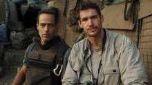 Sebastian Junger (left) with Tim Hetherington at the Restrepo outpost in the Korengal Valley, Afghanistan. (Tim Hetherington)