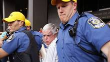 Earl Jones is rushed out of the courthouse in Montreal, July 28, 2009. (SHAUN BEST)