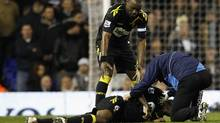 Bolton Wanderers' Nigel Reo-Coker helps a member of the club's medical staff attend to Fabrice Muamba after he collapsed on the pitch during their FA Cup quarter-final soccer match against Tottenham Hotspur at White Hart Lane in London March 17, 2012. (Suzanne Plunkett / Reuters/Suzanne Plunkett / Reuters)