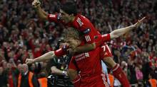 Liverpool's Dirk Kuyt, left, celebrates scoring with Luis Suarez against Cardiff City during their English League Cup final soccer match at Wembley Stadium in London on Sunday. (EDDIE KEOGH)
