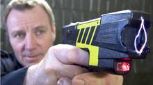 Sergeant Gord McNevan demonstrates the use of a taser at police headquarters in Peterborough, Ont. (CLIFFORD SKARSTEDT JR)