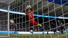 Vancouver Whitecaps goalkeeper David Ousted, of Denmark, allows a goal to Portland Timbers' Maximiliano Urruti during the second half of an MLS soccer game in Vancouver, B.C., on Saturday August 30, 2014. (Darryl Dyck/THE CANADIAN PRESS)