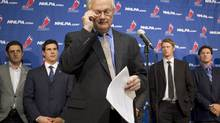 NHLPA Executive Director Donald Fehr (centre) glances at his notes as he stands in front of players, including Sidney Crosby (centre left) following collective bargaining talks in Toronto on Thursday October 18, 2012. (Chris Young/THE CANADIAN PRESS)