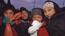 Davis Inlet children sniff gas in 2001, the year before Simeon Tshakapesh first headed the band council. (Arlene Gottfried)