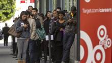 Hundreds of prospective candidates await their turn to apply for job openings at a Target job fair in Los Angeles Thursday, Jan. 10, 2013. (Damian Dovarganes/AP)
