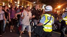 Protesters jeer and scream at police as they push them back away from the Grand Prix festival area in Montreal Saturday, June 9, 2012. (Peter McCabe/Canadian Press)