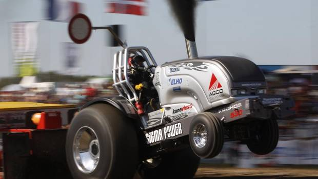 A driver competes in his tractor during the Tractor Pulling Euro Championships in the western German town of Fuechtorf September 9, 2012. Eighty teams from across Europe participated in the two-day competition where high-powered tractor prototypes must pull a trailer down a 100 metre track as far as possible. (INA FASSBENDER/REUTERS)