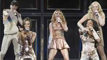 The Spice Girls(from left) Melanie Chisholm, Victoria Beckham, Geri Halliwell, Melanie Brown and Emma Bunton perform at GM Place in Vancouver, B.C. Sunday, December 2, 2007. (The Canadian Press)
