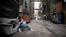 A drug user smokes crack in Vancouver's Downtown Eastside in February of 2009. (JOHN LEHMANN/John Lehmann/Globe and Mail)