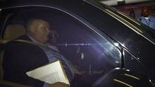 Toronto Mayor Rob Ford sit in the passenger seat of his car, driven by his new driver, leaving the underground parking garage at Toronto City Hall on Nov. 7, 2013. (FRED LUM/THE GLOBE AND MAIL)