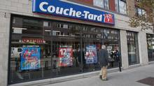 A man passes by a Couche-Tard convenience store in Montreal in 2012. (Graham Hughes/The Canadian Press)