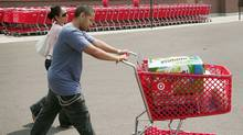 Customers leave a Target store with a cart full of merchandise in Chicago in 2007. (Scott Olson/Getty Images/Scott Olson/Getty Images)