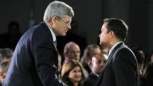 Prime Minister Stephen Harper shakes hands with Shawn Atleo, National Chief of the Assembly of First Nations, in Ottawa on Tuesday, January 24, 2012. (Sean Kilpatrick/THE CANADIAN PRESS)