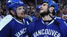 Daniel Sedin #22 and Kevin Bieksa #3 of the Vancouver Canucks celebrate after defeating the San Jose Sharks 3-2 in double-overtime in Game Five to win the Western Conference Finals during the 2011 Stanley Cup Playoffs at Rogers Arena on May 24, 2011 in Vancouver, British Columbia, Canada. Bieksa got the game-winning goal in the second overtime to win the series four games to two. (Photo by Harry How/Getty Images) (Harry How/Getty Images)