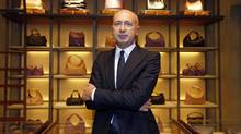 Marco Bizzari, president and CEO of Bottega Veneta, poses at the company's shop in Paris Feb. 14, 2013. Bottega Veneta plans to invest in new shops as much in Western Europe as in emerging countries in the coming years even though sales growth rates are higher in new markets, its chief executive said. (CHARLES PLATIAU/Reuters)