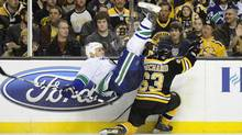 Boston Bruins left wing Brad Marchand upends Vancouver Canucks defenceman Sami Salo during the second period at TD Garden in Boston on Saturday. (Bob DeChiara-US PRESSWIRE/Bob DeChiara)