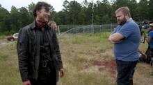 Robert Kirkman, right, on the set of The Walking Dead with actor David Morrissey during filming for the show's fourth season. (Gene Page/AMC)