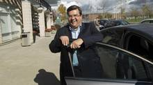 Montreal mayoral candidate Denis Coderre smiles as he leaves a seniors residence while on the campaign trail on Oct. 18, 2013. (GRAHAM HUGHES/THE CANADIAN PRESS)