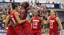 Canada's Miranda Ayim (left) and Tamara Tatham (2nd left) embrace as fellow teammates Nirra Fields (2nd right) and Lizanne Murphy (right) celebrate a basket against Cuba during first half action of the 2015 FIBA Americas Women's Championship Final in Edmonton, Alta., on Aug. 16, 2015. (JASON FRANSON/THE CANADIAN PRESS)