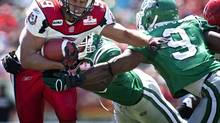 Saskatchewan Roughriders Barrin Simpson, right, tries to stop Calgary Stampeders Jon Cornish, during first half pre-season CFL football action in Calgary, Sunday, June 20, 2010. (Jeff McIntosh/THE CANADIAN PRESS)