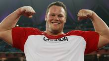 Dylan Armstrong of Canada celebrates after the men's shot put final at the Jawaharlal Nehru Stadium during day four of the Delhi 2010 Commonwealth Games on October 7, 2010 in Delhi, India. (Photo by Michael Steele/Getty Images) (Michael Steele/Getty Images)