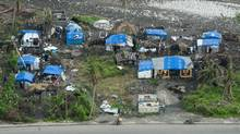 Roofs are seen ripped open following the passing of Hurricane Matthew Thursday, November 17, 2016 in Les Cayes, Haiti. (Paul Chiasson/THE CANADIAN PRESS)