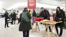 Shoppers examine merchandise in The Bay at Hillcrest Mall in Richmond Hill, Ont., on Dec. 21, 2013. (Matthew Sherwood for The Globe and Mail)