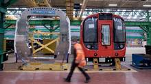 An employee passes components used in the assembly of London Underground tube train carriages at Britain's sole remaining railcar factory, operated by Bombardier Inc. and known as Litchurch Lane, in Derby, U.K., on Wednesday, Dec. 21, 2011. (Jason Alden/Bloomberg)