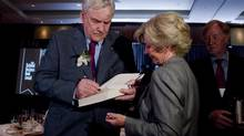 Conrad Black signs a copy of his book at the National Business Book Awards in Toronto May 28, 2012. He was one of the three finalists for the award last year, which was won by Bruce Philp. (Chris Young/THE CANADIAN PRESS)