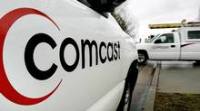 Comcast technicians head out on a job. (Douglas C. Pizac/AP)