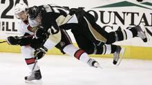 Pittsburgh Penguins Evgeni Malkin (71) hits Ottawa Senators Erik Karlsson (L) in the first overtime period of Game 5 of their NHL Eastern Conference quarter-final hockey game in Pittsburgh, Pennsylvania April 22, 2010. (JASON COHN/REUTERS)