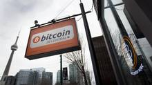 A new bitcoin ATM in Toronto offers evidence of the cryptocurrency's growing appeal. (Peter Power/The Globe and Mail)