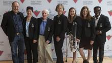 """From left, Bryan Tottier, Annie Perreault, Dr Frank Hayden, Sue Holloway, Stephanie Dixon, Colleen Jones and Michael """"Pinball"""" Clemons gather for a group photo, after being formally inducted into Canada's Sports Hall of Fame in Toronto on Nov. 1, 2016. (Chris Young/THE CANADIAN PRESS)"""