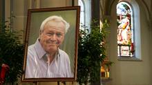 Arnold Palmer's portrait is displayed on the altar during a Celebration of Arnold Palmer at Saint Vincent College on October 4, 2016 in Latrobe, Pennsylvania. (Hunter Martin/Getty Images)