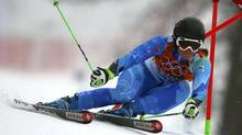 Slovenia's Tina Maze clears a gate during the first run of the women's alpine skiing giant slalom event at the 2014 Sochi Winter Olympics at the Rosa Khutor Alpine Center February 18, 2014. (Reuters)