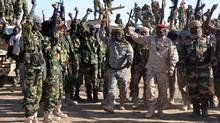 Chadian solfiers gather on Feb. 1, 2015, near the Nigerian town of Gamboru, just accros the border from Cameroon. (MARLE/AFP/GETTY IMAGES)