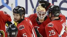Ottawa Senators' Andrew Hammond (30) celebrates his team's shut-out victory over the Montreal Canadiens following third period NHL hockey action in Ottawa on Saturday, March 19, 2016. (Justin Tang/THE CANADIAN PRESS)